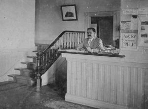 Peter Lee at V-House Desk - Hawaii State Archives